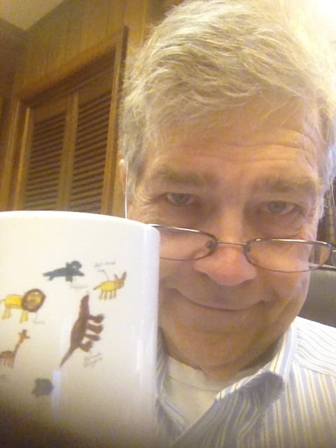Dean Halliday Smith Holding Coffee Cup